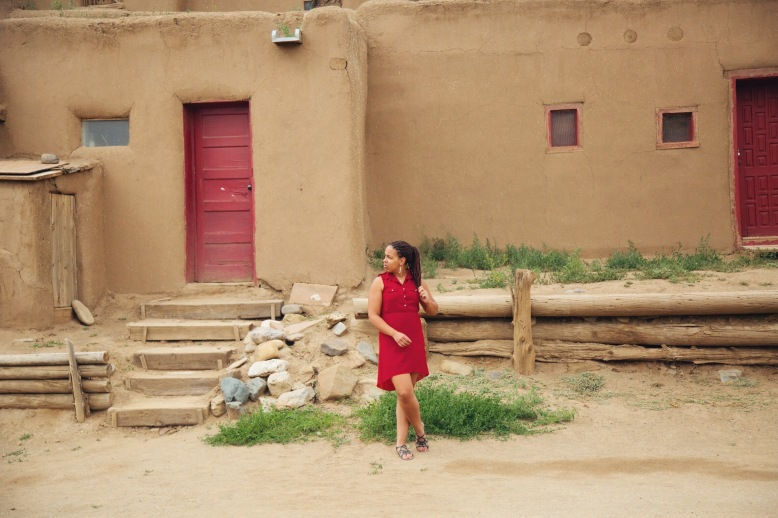 In front of one of the homes at Taos Pueblo