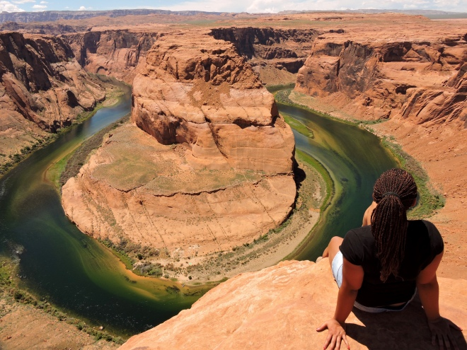 Me sitting on the edge looking over Horseshoe Bend in Page, AZ.
