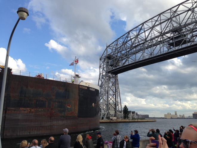 Barge going under Aerial Lift Bridge at Canal Park in Duluth, Minnesota